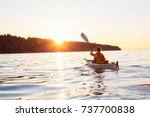woman on a sea kayak is... | Shutterstock . vector #737700838