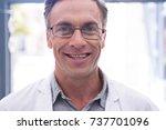 portrait of smiling dentist...   Shutterstock . vector #737701096