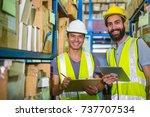 warehouse worker checking stock ... | Shutterstock . vector #737707534