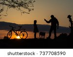 man and girl silhouettes at... | Shutterstock . vector #737708590