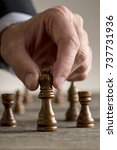 man playing chess moving black... | Shutterstock . vector #737731936