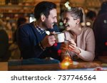 Small photo of Happy couple talking at bar and having date
