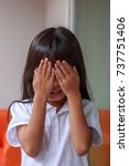 little girl is playing hide and ... | Shutterstock . vector #737751406