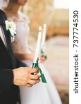 Small photo of Wedding couple bide and groom get married in a church