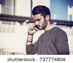 handsome man doing a phone call ... | Shutterstock . vector #737774806