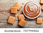 melted caramel with pieces of... | Shutterstock . vector #737794963
