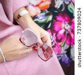 bag in female hands closeup.... | Shutterstock . vector #737809024