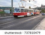 retro tram on the bridge with... | Shutterstock . vector #737810479