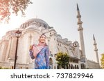 Happy Attractive Muslim Woman...