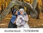 happy senior woman with her... | Shutterstock . vector #737838448