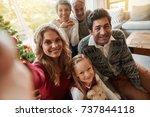 happy extended family taking... | Shutterstock . vector #737844118