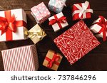 christmas gift on wood. | Shutterstock . vector #737846296