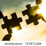 two hands trying to connect... | Shutterstock . vector #737871184