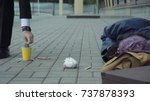 rich man passerby giving money... | Shutterstock . vector #737878393