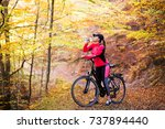 beautiful girl riding a bicycle ... | Shutterstock . vector #737894440