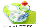 bright baby tableware and bib... | Shutterstock . vector #737894740