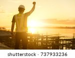 happy engineer or safety... | Shutterstock . vector #737933236
