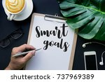 smart goals text with hand... | Shutterstock . vector #737969389