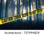 crime scene tape in the woods | Shutterstock . vector #737994829