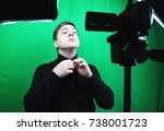 television presenter in a green ... | Shutterstock . vector #738001723