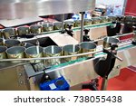 empty cans on the conveyor of a ... | Shutterstock . vector #738055438
