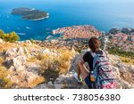 woman tourist looks to the old... | Shutterstock . vector #738056380