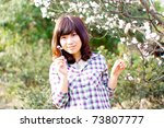 Half-length close-up smiling Chinese girl - stock photo