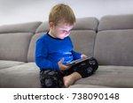 little toddler boy watch... | Shutterstock . vector #738090148