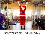 santa claus in the gym doing... | Shutterstock . vector #738102379