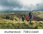 Group Of Hikers Walking Along...