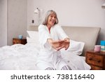 senior woman waking up and... | Shutterstock . vector #738116440
