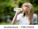 beautiful blonde girl drinking... | Shutterstock . vector #738119653