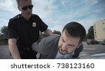 police officer arresting... | Shutterstock . vector #738123160