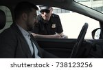 policeman stopping a driver in... | Shutterstock . vector #738123256