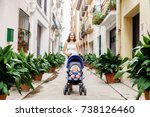 mother walking with a baby pram ... | Shutterstock . vector #738126460
