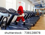 santa claus in the gym doing...   Shutterstock . vector #738128878