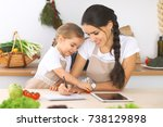happy family in the kitchen.... | Shutterstock . vector #738129898