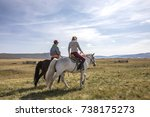 couple riding horses in a... | Shutterstock . vector #738175273