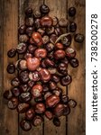 Small photo of Conkers on Wood Planks, Horse Chestnut, Autumn Fall Background Equinox Buckeye Rustic Texture