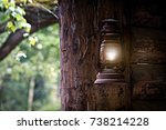 gasoline lamp hanging of a tree ... | Shutterstock . vector #738214228