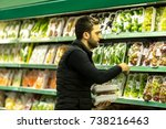 young man buying products at... | Shutterstock . vector #738216463