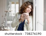 woman holding cup of warm drink | Shutterstock . vector #738276190