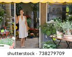 woman standing in a flower shop | Shutterstock . vector #738279709