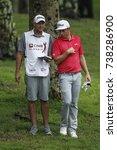 Small photo of KUALA LUMPUR, MALAYSIA - OCTOBER 13, 2017. Cameron Smith of Australia talk with his caddie during the 2017 CIMB Classic golf tournament at TPC Kuala Lumpur, Bukit Kiara.