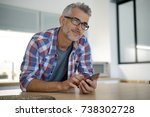 middle aged man at home using...   Shutterstock . vector #738302728
