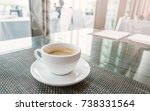 white cup of hot coffee on... | Shutterstock . vector #738331564