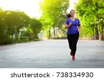 overweight young woman jogging... | Shutterstock . vector #738334930