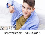 young preteen smiling with... | Shutterstock . vector #738355054
