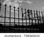 lonely black and white fence | Shutterstock . vector #738360610