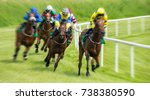Stock photo race horses and jockeys motion blur zoom effect 738380590